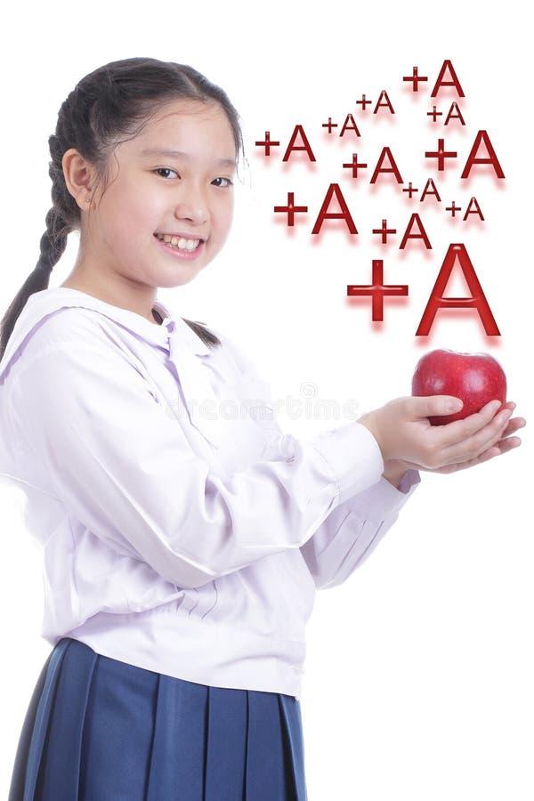 Mela di rosso della tenuta della ragazza dello studente immagini stock