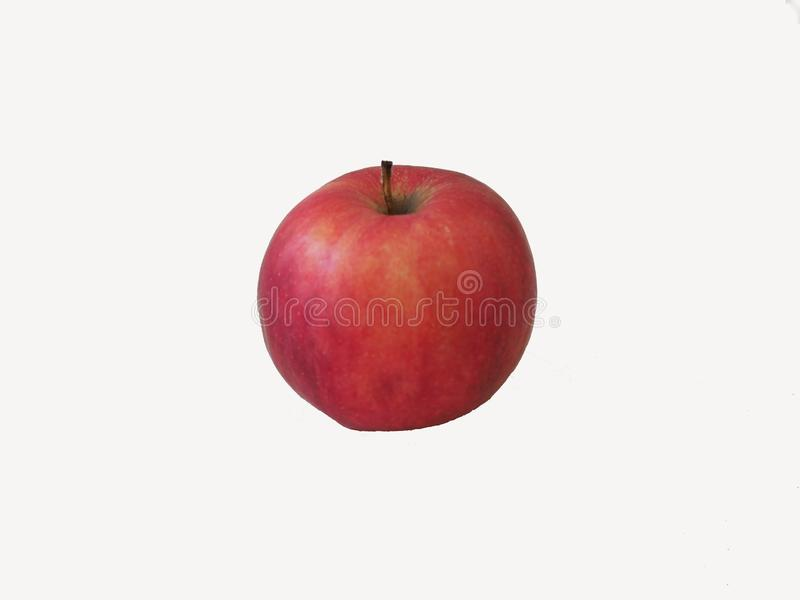Mela rossa fresca isolata su bianco Fine in su fotografie stock libere da diritti