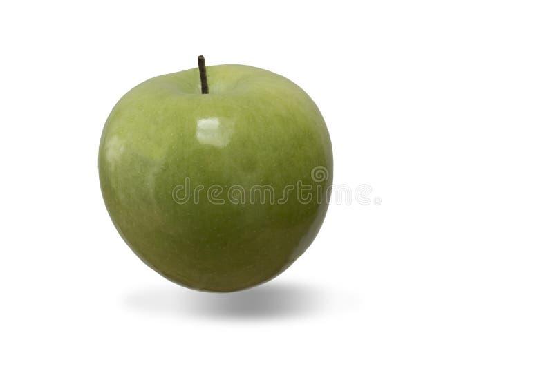 Mela verde acida con un'ombra fotografie stock libere da diritti