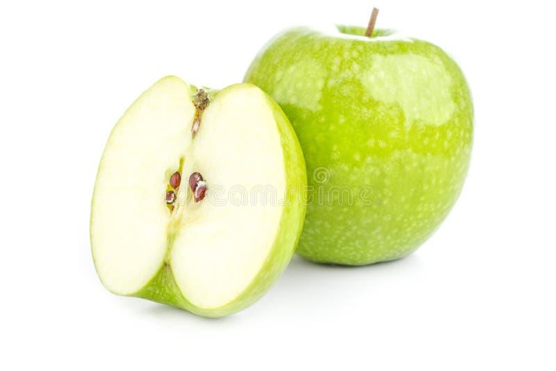 Mela verde succosa su un fondo bianco fotografia stock