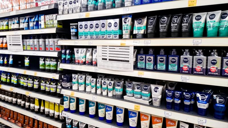 MELAKA, MALAYSIA - April 13, 2018 : Assorted brand and type man and woman care product on shelf rack display in the Tesco store. MELAKA, MALAYSIA - April 13 royalty free stock photos