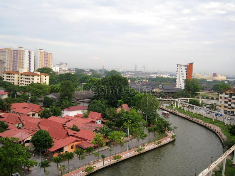 Melaka river among building stock images