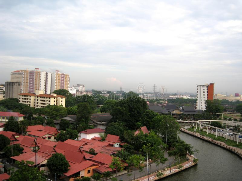 Melaka river among building royalty free stock image