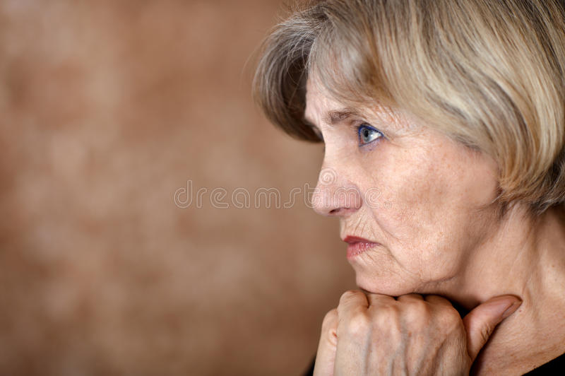 Melancholy older woman