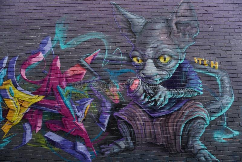 MELBOURNE, AUSTRALIA - 15 agosto 2017 - murales dei graffiti delle pitture di parete sulle vie della città fotografia stock