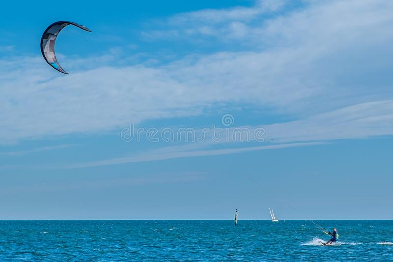 Kite surfer practicing in Port Phillip Bay. MELBOURNE, AUSTRALIA - 31 AUGUST, 2019: Kite surfer practicing in Port Phillip Bay near Brighton Beach stock image