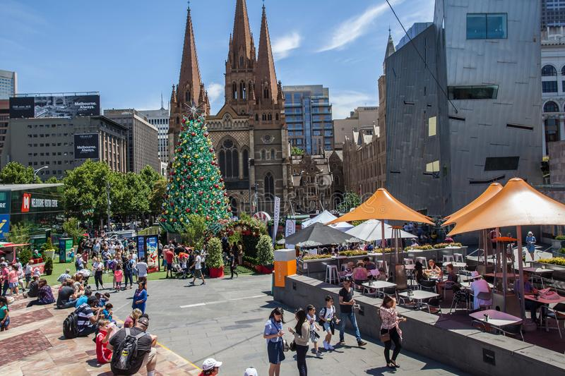 Melbourne, Australia - December 16, 2017: Almost Christmas at Federation Square. People gathering around huge beautiful Christmas. stock photos