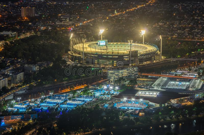 Melbourne Cricket Ground and Yarra Park tennis stadium illuminated at sunset. Melbourne, Australia - January 16, 2018: aerial view of Yarra Park, illuminated royalty free stock photography
