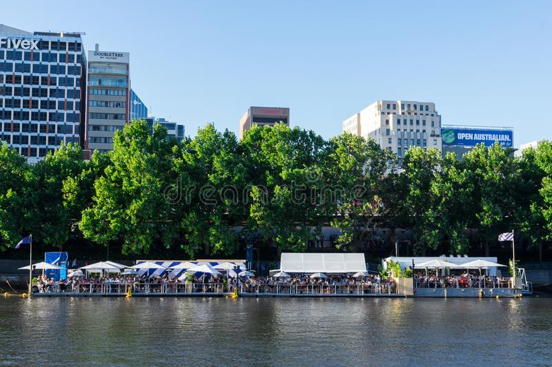 Arbory Afloat floating bar on the Yarra River in Melbourne. Melbourne, Australia - January 16, 2018: Arbory Afloat floating bar on the northern bank of the Yarra royalty free stock image
