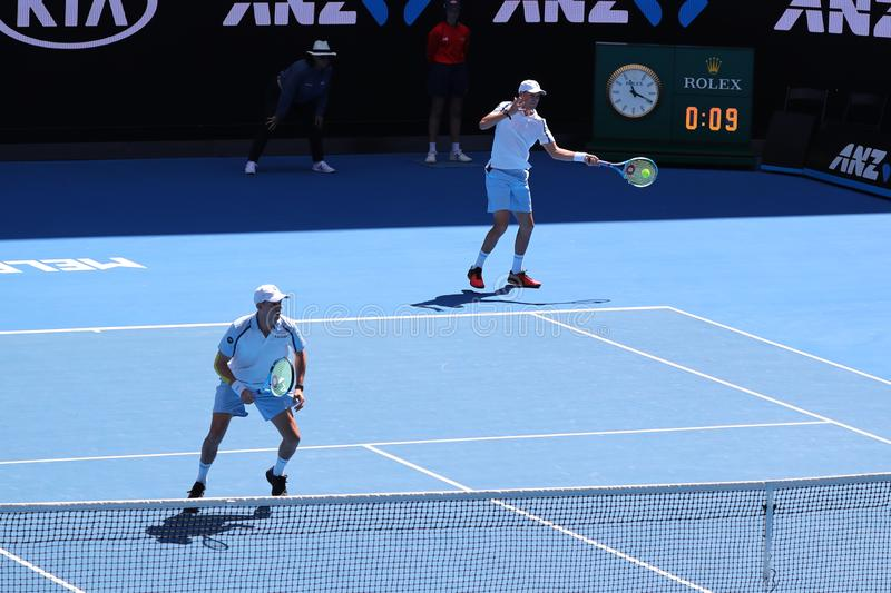Grand Slam champions Mike and Bob Bryan of United States in action during quarterfinal match at 2019 Australian Open in Melbourne. MELBOURNE, AUSTRALIA - JANUARY royalty free stock image