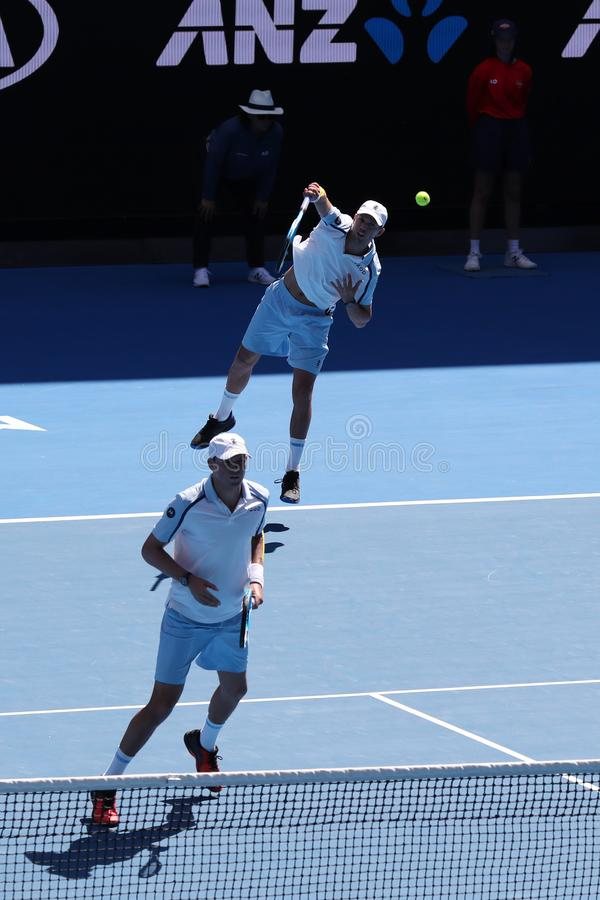 Grand Slam champions Mike and Bob Bryan of United States in action during quarterfinal match at 2019 Australian Open in Melbourne. MELBOURNE, AUSTRALIA - JANUARY stock photo