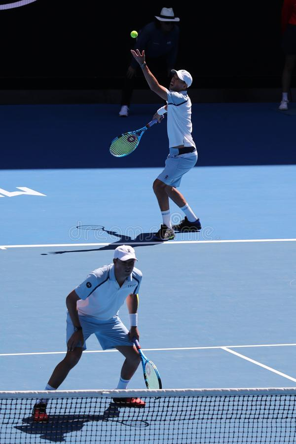 Grand Slam champions Mike and Bob Bryan of United States in action during quarterfinal match at 2019 Australian Open in Melbourne. MELBOURNE, AUSTRALIA - JANUARY stock image