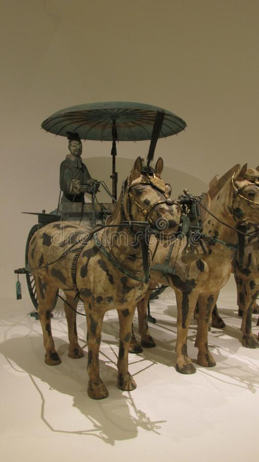 Horse chariot made in bronze with gold and silver decoration stock images