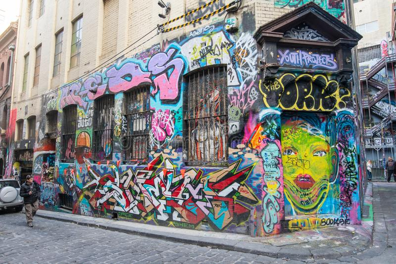 Melbourne, AUSTRALIA - JULY 5 2015: Hosier lane the famous street art lane in Melbourne, Victoria state of Australia. Taking a walk down Hosier Lane in stock images