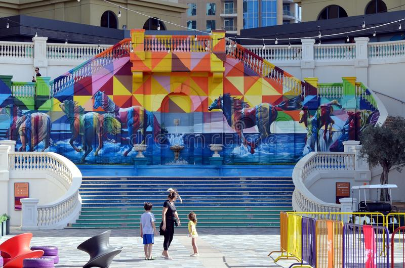 Bright abstract mural with horses in Dubai Marina district, UAE stock photography