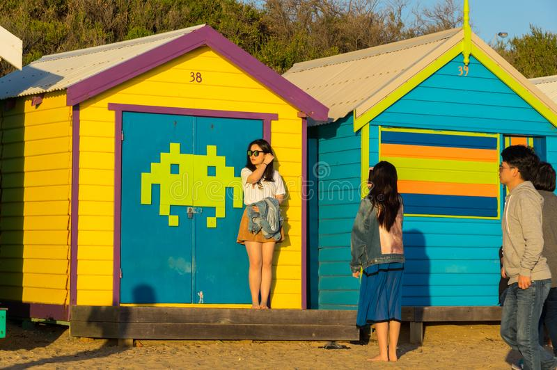 Melbourne, Australia - March 31, 2018: Tourists posing in front of colourful bathing boxes at Brighton Beach, a popular inner city stock images
