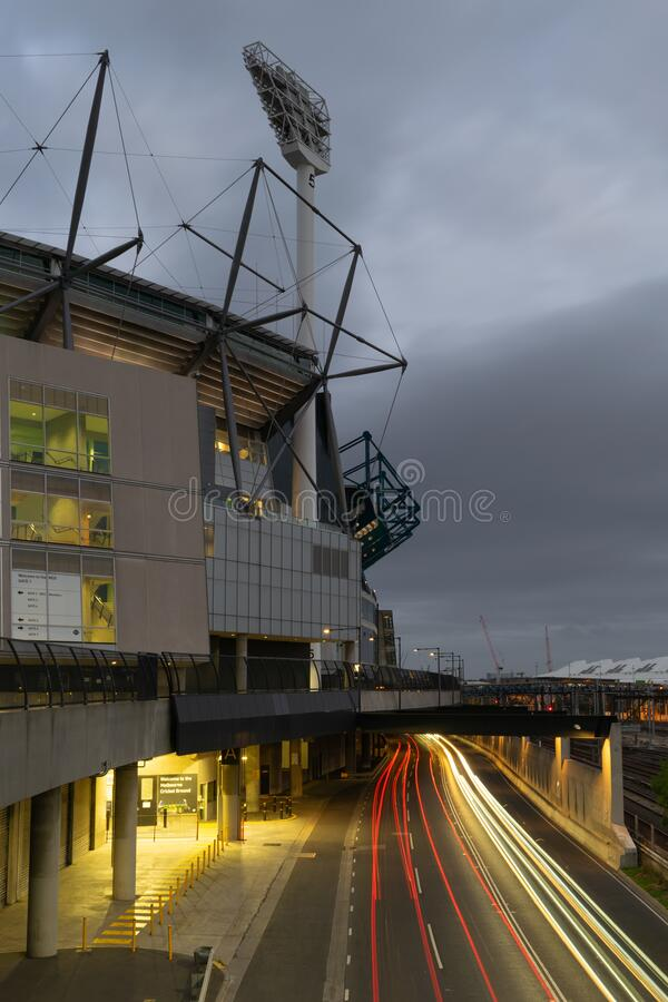 MELBOURNE, AUSTRALIA - 15 November 2019: Car light trail outside the Melbourne Cricket Ground with a grey sky. royalty free stock photos