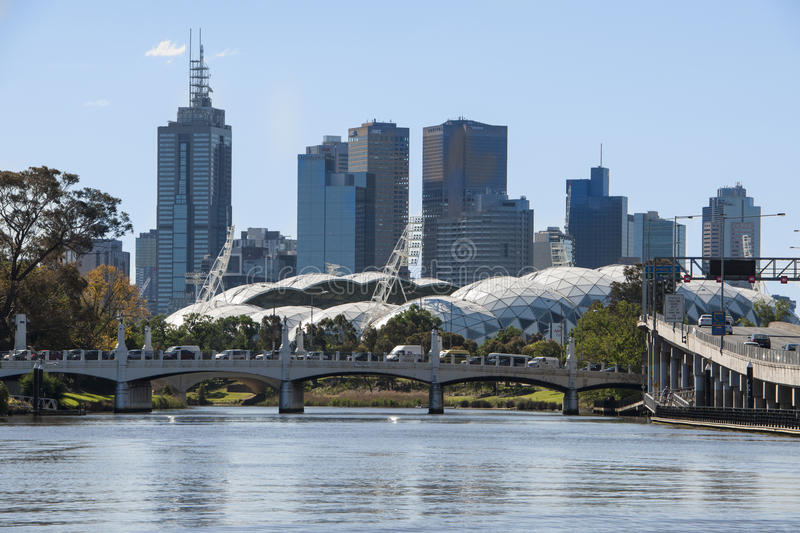 Melbourne Rectangular Stadium – AAMI Sport Stadium. Melbourne Rectangular Stadium known commercially also as AAMI Sport Stadium with skyscrapers in the stock images