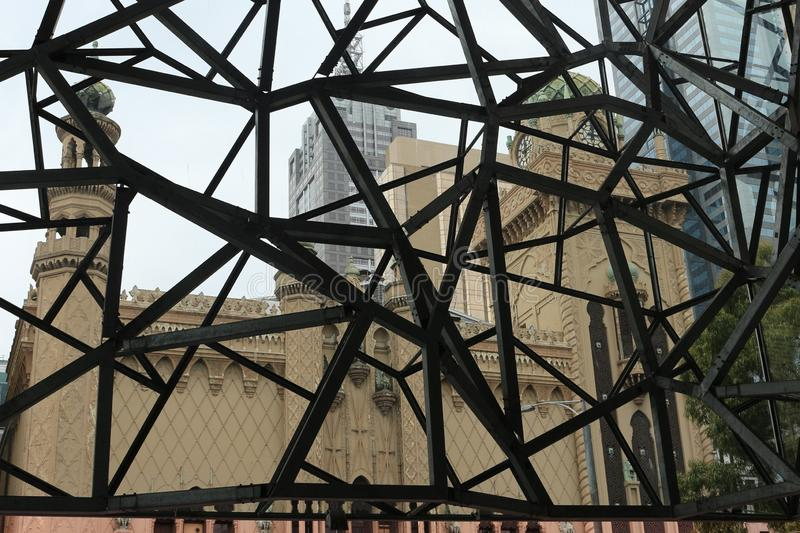 View at Moorish revival architecture through the modern steel construction of Ian Potter Center in Melbourne, Australia stock photos