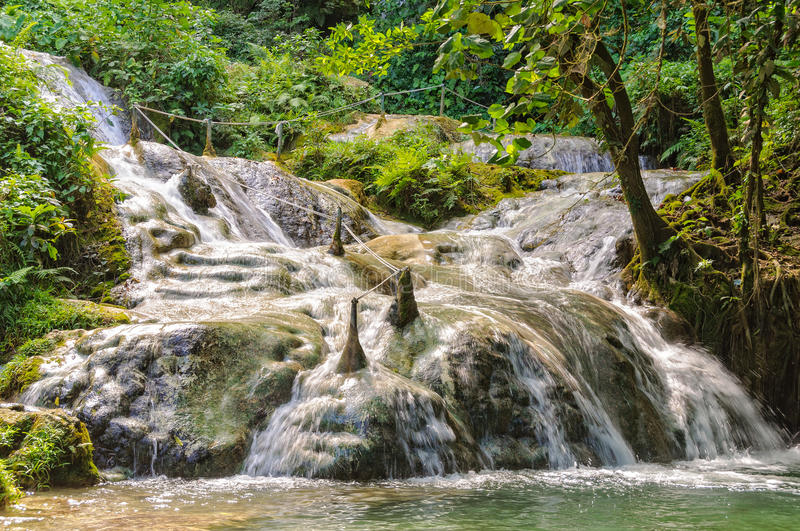 Mele Cascades - Port Vila. At Mele Cascades Waterfalls a slippery path with guide ropes climbs the hillside through a series of beautiful pools - Port Vila stock images