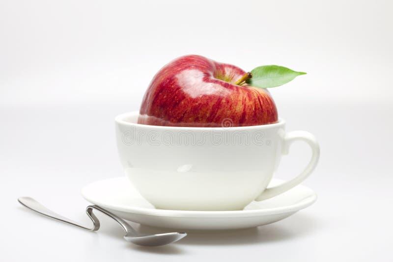 Mele in una tazza fotografie stock