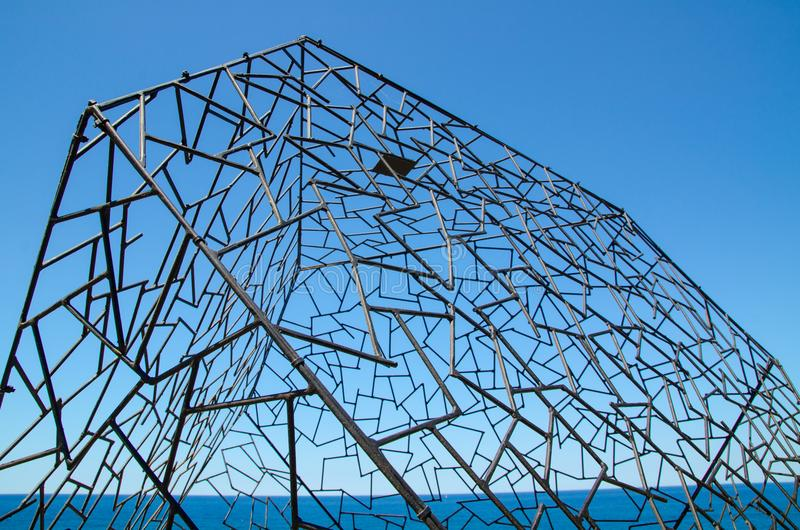 ` Melencolia ` is a sculptural artwork by Simon Hodgson at the Sculpture by the Sea annual events free to the public sculpture. SYDNEY, AUSTRALIA. – On royalty free stock image