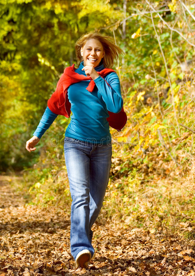 Meli 1. Girl taking a walk in an autumn-forest royalty free stock images