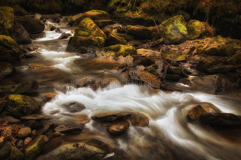 Melincourt Brook riverbed. The rocky river bed at Melincourt Brook in Resolven, South Wales, UK royalty free stock photography