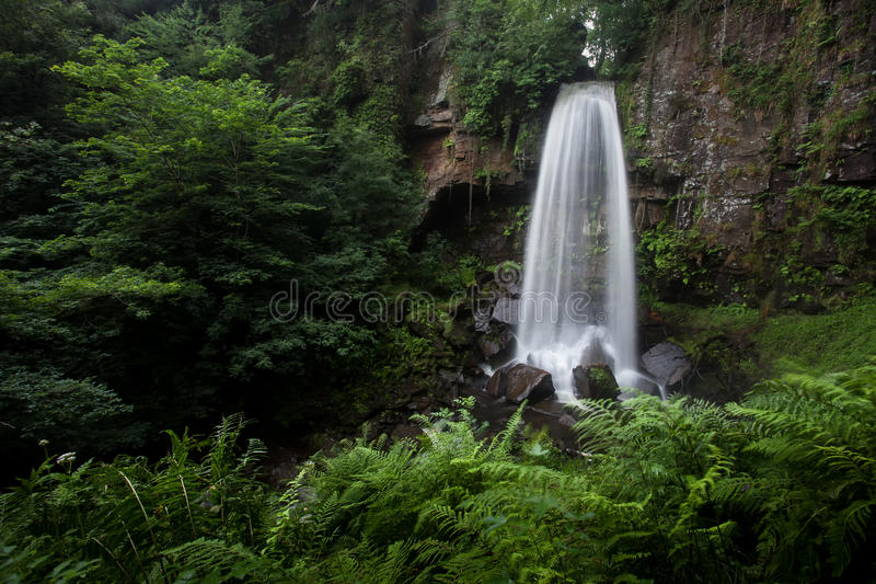 Melincourt falls near Resolven south Wales. Beautiful tall waterfall in Resolven, near Neath, south Wales royalty free stock images