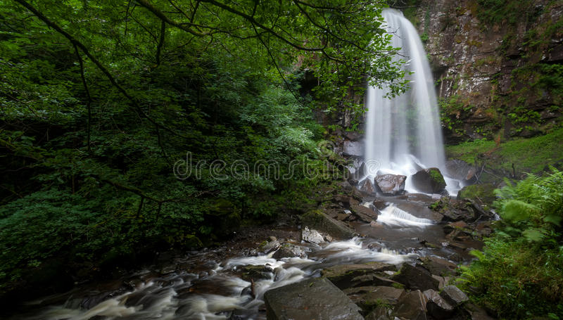 Melincourt falls Resolven south Wales. Beautiful tall waterfall in Resolven, near Neath, south Wales royalty free stock image