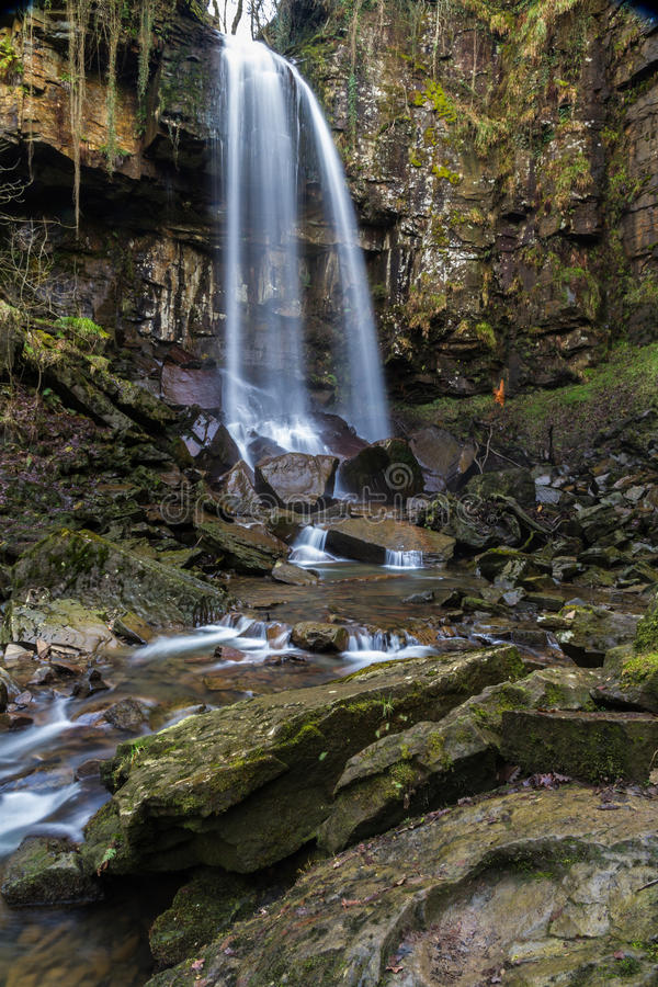 Melincourt waterfall. Tranquil high waterfall. Melincourt Falls, Resolven, Vale of Neath, Port Talbot, Wales, United Kingdom royalty free stock photos