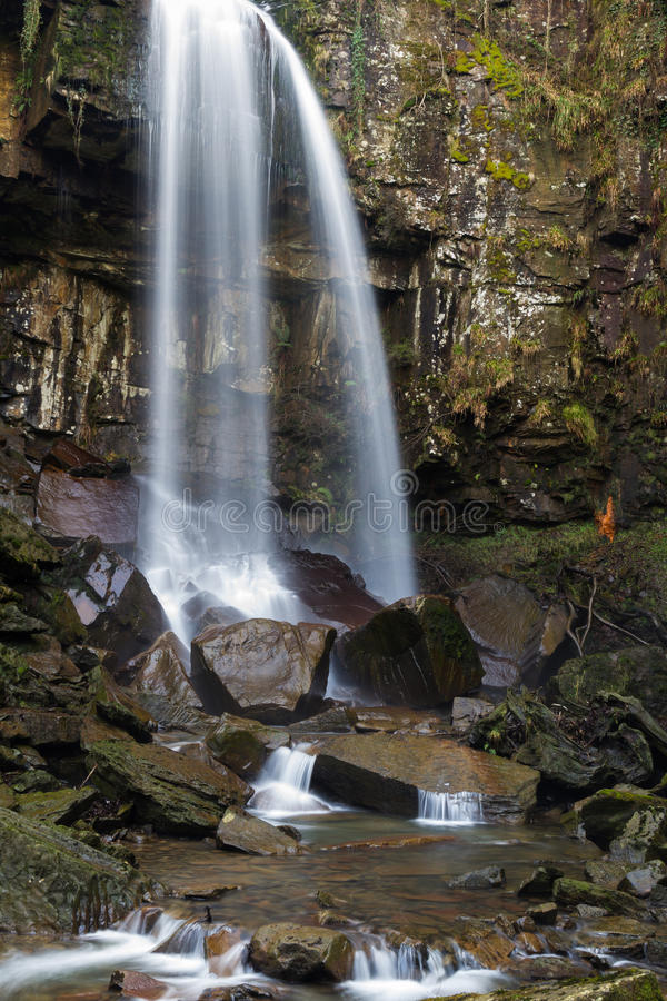 Melincourt waterfall. Tranquil high waterfall. Melincourt Falls, Resolven, Vale of Neath, Port Talbot, Wales, United Kingdom stock images