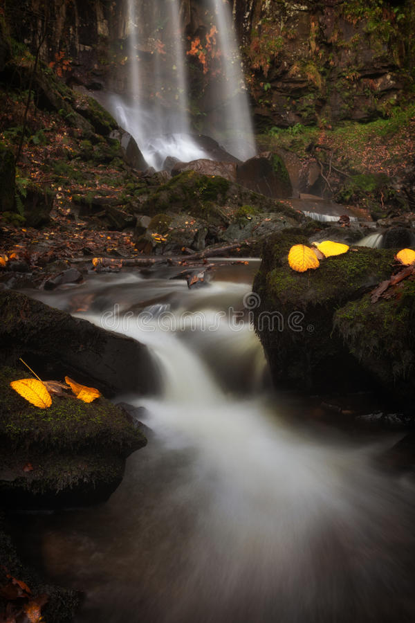 Melincourt Waterfalls in Autumn. Beautiful Autumn leaves at Melincourt waterfalls in Resolven, near Neath, South Wales stock photo