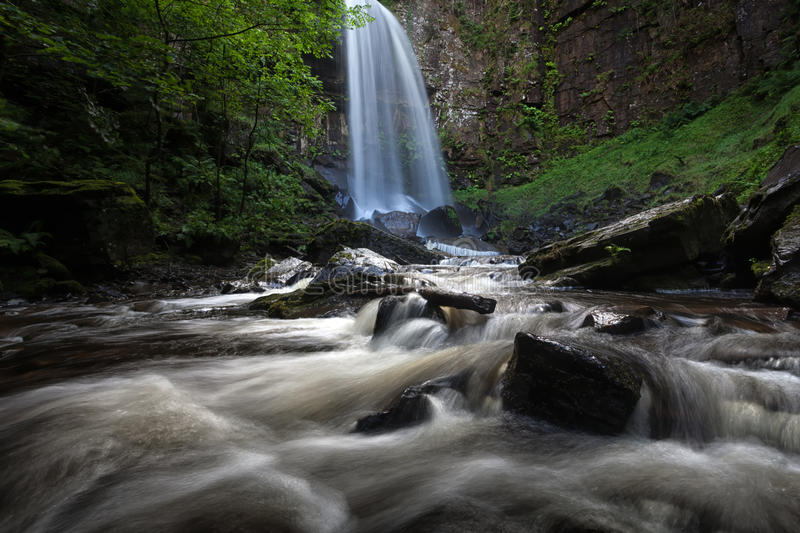 Melincourt waterfalls at Resolven south Wales. Beautiful tall waterfall in Resolven, near Neath, south Wales royalty free stock photo