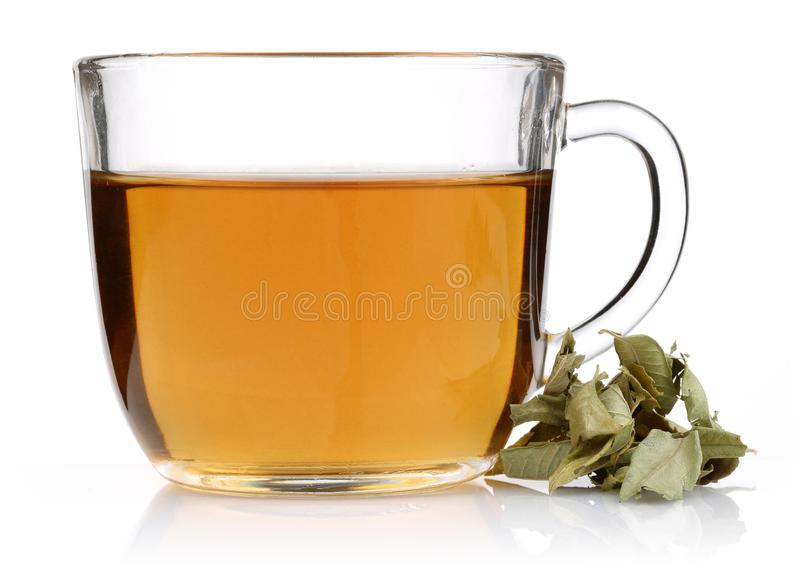 Melissa tea in a glass cup with lemon balm. Leaves isolated on white background stock photography