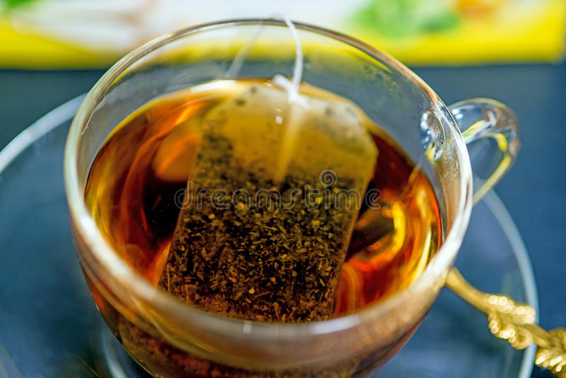 Melissa tea. With teabag in a glass royalty free stock image