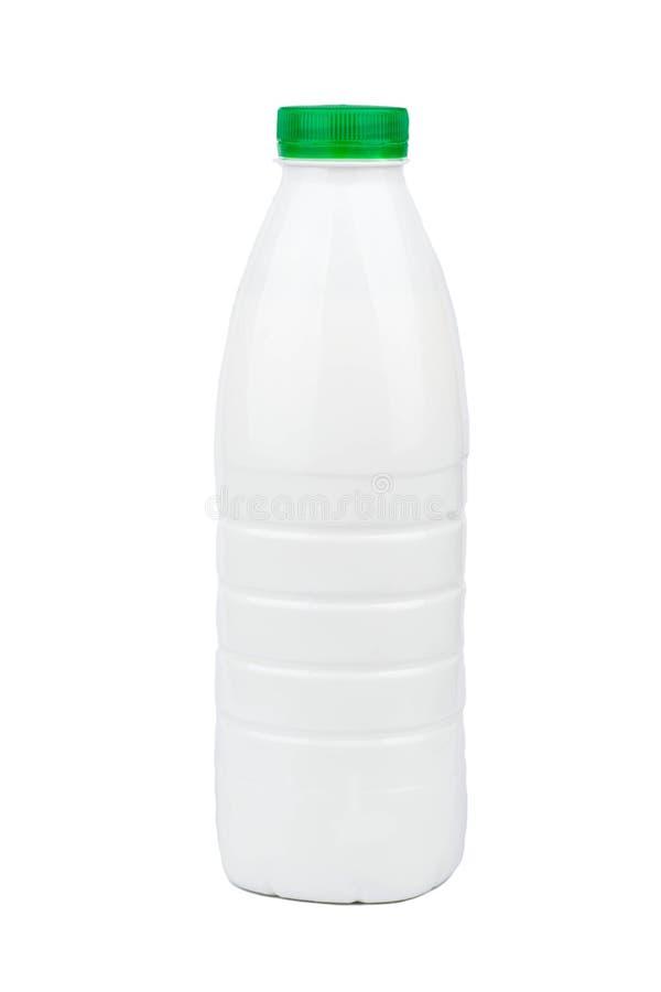 Melk in een fles stock afbeeldingen