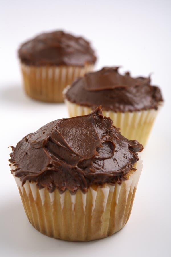 Melkchocola en Vanille Cupcakes stock fotografie