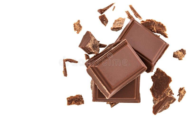 Melkchocolastukken op witte achtergrond van hoogste mening worden geïsoleerd die stock afbeeldingen