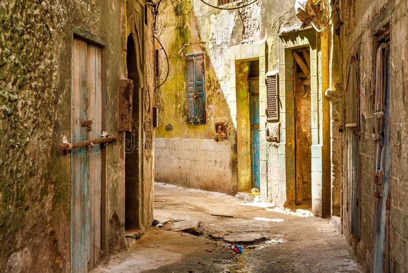 Mellah district in the medina of Essaouira. The dilapidated buildings of a small street in the Mellah district in Essaouira, Morocco stock images