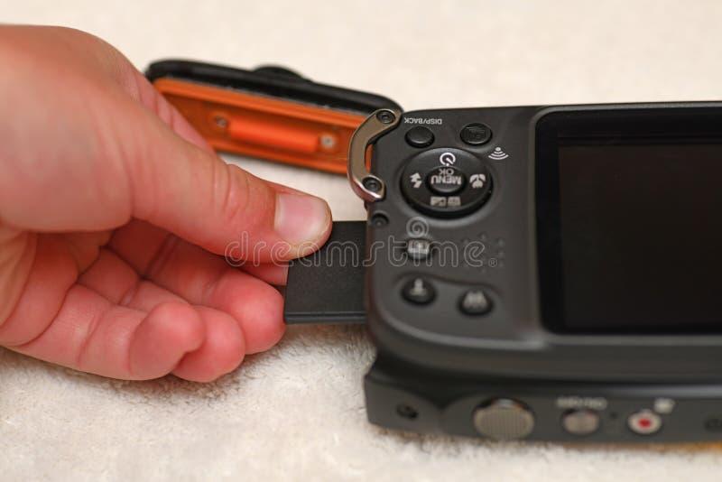 mellanläggsminnespinne in i ny kamera royaltyfri bild