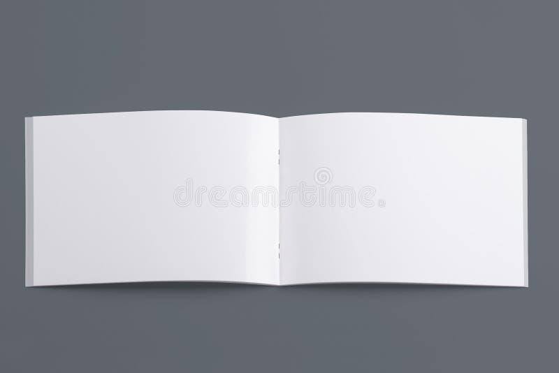 Mellanrum öppnad tidskrift som isoleras på grå färger royaltyfri fotografi