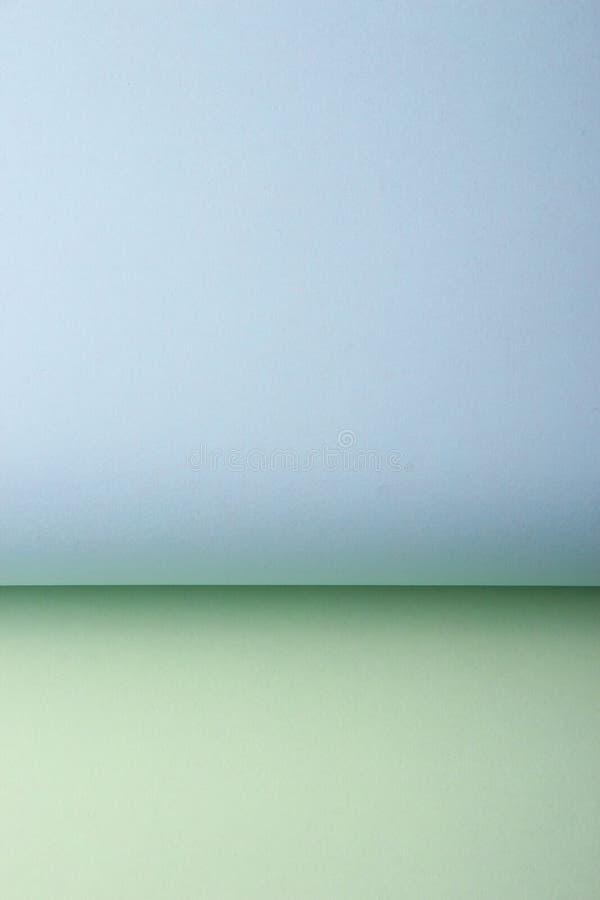 Mellanrum färgad pappers- bakgrund arkivbilder