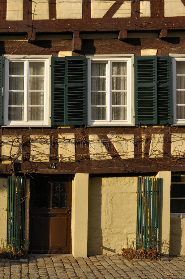 Mellow yellow facade, tubingen. Detail of old wattle building in city center, shot in bright winter light stock images