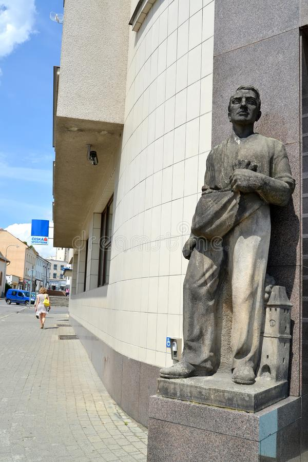 MELNIK, CZECH REPUBLIC. A sculpture of the sower at an entrance to the Czech savings bank royalty free stock image