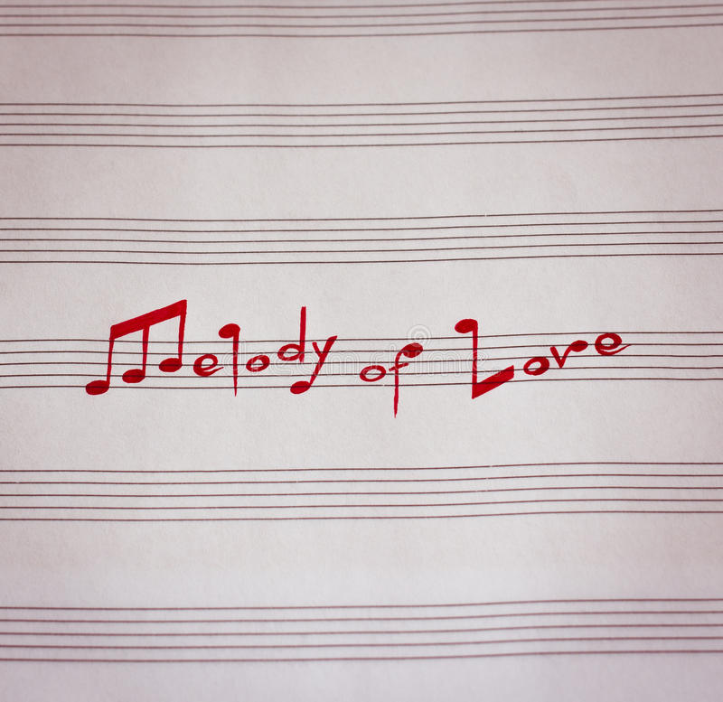 Melody of Love. Words in shape of music notes in musical note book stock photos
