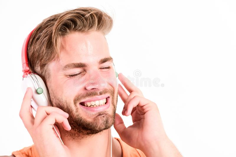 Melody put over various types of music. It is great time to be creating new realities. Man handsome bearded guy. Listening music headphones white background stock photos