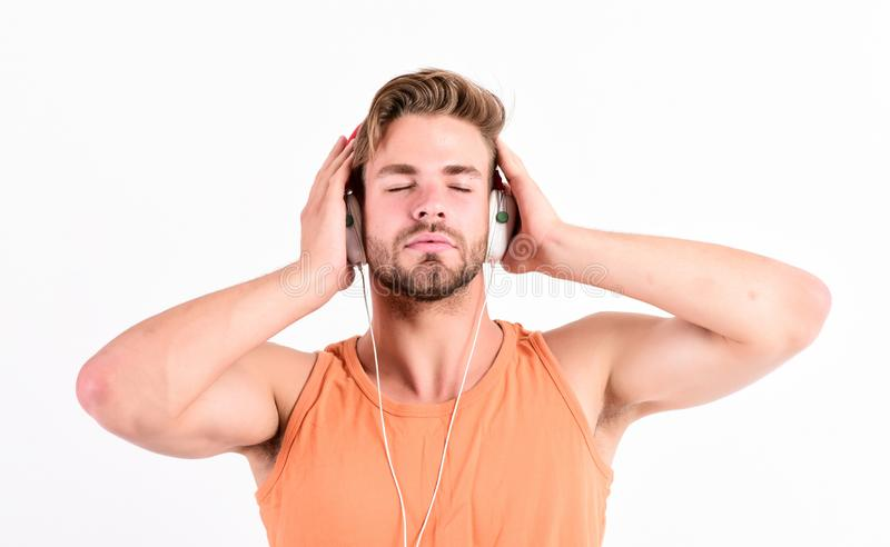 Melody put over various types of music. Music fan concept. It is great time to be creating new realities. Man handsome. Bearded guy listening music headphones stock image