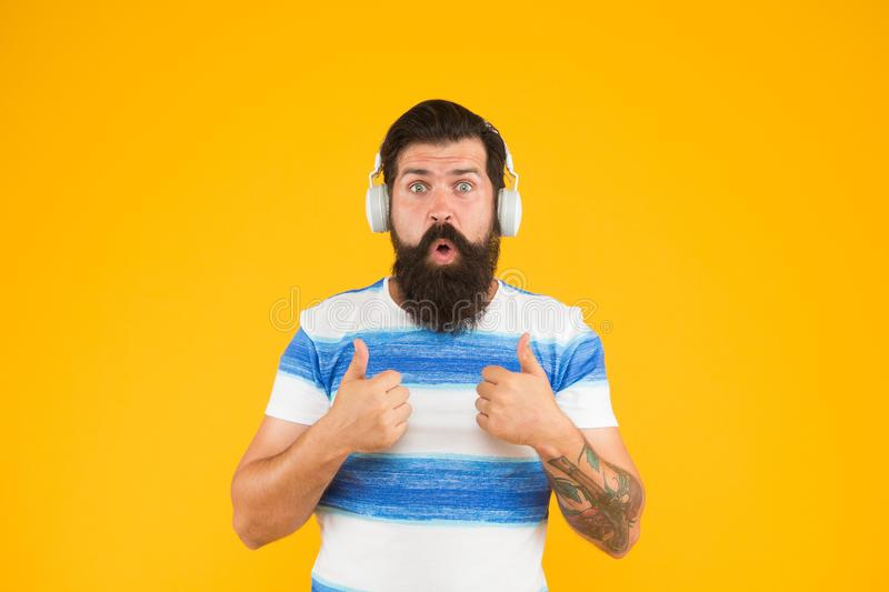 Melody for relax. Summer playlist. Music for summer vacation. Guy dressed striped shirt on summer vacation. Man bearded. Hipster with mustache long beard stock image