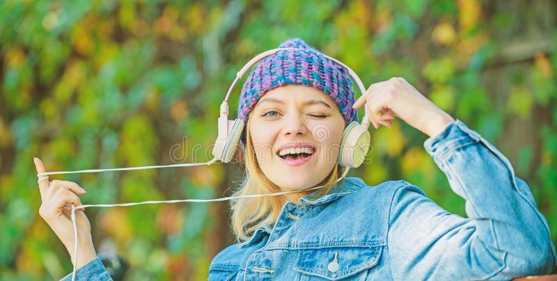 Melody sound and mp3. Music fan concept. Headphones must have modern gadget. Enjoy powerful sound. Feeling awesome. Cool. Funky girl enjoy music in headphones stock photo